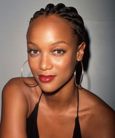 Tyra Banks, Our '90s Rihanna-In-Training #refinery29  http://www.refinery29.com/tyra-banks-lookbook-throwback-90s-fashion