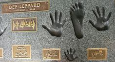 Rock Walk of Fame -- Def Leppard Handprints by Bargain Betty, via Flickr  (Rick's foot and his daughters little bity hand)