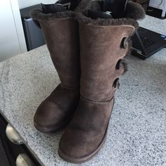 100% Authentic Chocolate Ugg Boots Generously worn Ugg boots.  Size 8 chocolate color.  Has buttons on the side and can we worn up or, folded down.  No trades. Price is firm. UGG Shoes Winter & Rain Boots