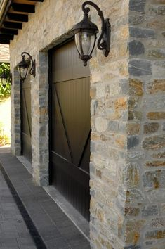 Natural Ledgestone veneer is installed on the exterior of the garage. Stone Cladding Exterior, Stone Veneer Exterior, Stone Exterior Houses, Old Stone Houses, Wall Exterior, Exterior Design, Natural Stone Cladding, Brick Face, Garage Door Design