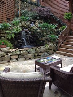 A beautiful Water Garden is the center piece of this courtyard garden. Stone Masonry, Outdoor Living Areas, Patio, Nice, Koi Ponds, Water Gardens, Outdoor Decor, Outdoor Kitchens, House