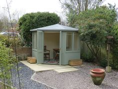 Newhaven corner summerhouse with reduced height roof to suit planning regulations. Pretty as a picture!