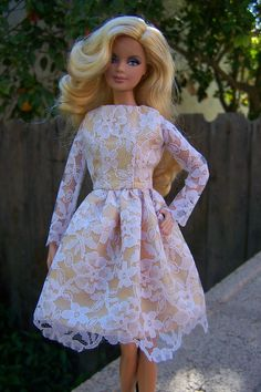 long-sleeved white lace dress for model muse Barbie. $23.00, via Etsy.