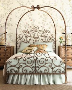 Tuscany Canopy Bed has great curving iron arms which arch to meet over head.