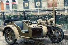 WWII BMW R75 Mot  One cold January afternoon in the Navigli area of Milan, we came across this well-preserved WWII BMW R75 motorcycle with its original sidecar. orcycle with Original Sidecar