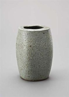 Squared vase with flat lip, Stoneware, green glaze. Mineral elements mixed into the body material producing a pitted, speckled surface. 23.5 cm. (9 1/4 in.) high, c.1960