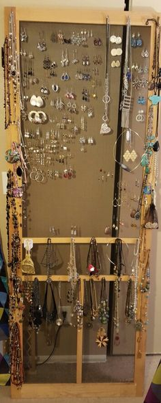 Use an old screen door as a jewelry organizer.