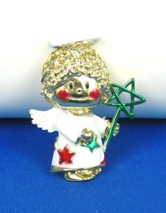 30% off sale until 11/23/15 Before Christmas Sale! A very unique Christmas themed #angel #pin from A.J.C. This pin is composed of a gold tone metal foundation which makes this angel holding a wand. The ... #ajc #red #green #white #holidays #judysgems2 #woj