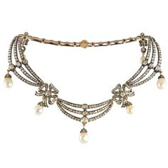 Magnificent draped Victorian necklace with diamonds and natural pearls, backed in 15kt gold and topped in silver. The necklace contains 7 off-white baroque-drop natural pearls and 369 old mine-cut, old European-cut and rose-cut diamonds weighing approx 14.86 carats.