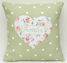 A great keepsake present and a lovely addition to any girls bedroom - this sweet personalised cushion has a lovely heart appliqué in a sprig print - embroidered with the name of your choice in the middle. The cushion measures approximately x . Sewing Pillows, Diy Pillows, Sewing Crafts, Sewing Projects, Sewing Ideas, Sewing Toys, Sewing Hacks, Love Sewing, Baby Sewing