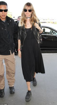 Not happy: Behati Prinsloo failed to raise a smile after arriving at LAX International air...