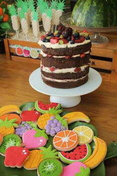 Incredible cookies and cake at a tutti frutti birthday party! See more party ideas at CatchMyParty.com!