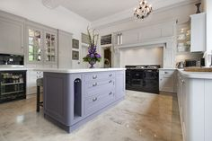 hand painted kitchen in equivilent colours to Farrow & Balls pavillion grey and brassica