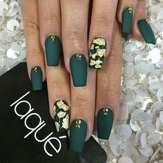 Flat forest green with foil accent nail and crystal accent on top of each nail