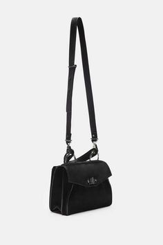 Modern convenience meets elegant structure and distinctive hardware in Proenza Schouler's new Hava bag in velvety nubuck sharpened by painted edges. With an adjustable, removable shoulder strap as well as a sleek top handle suspended by silver-toned rings, it is as effortlessly slung over the shoulder as it is toted or even carried under the arm. The leather-lined interior has two internal pockets and an external zippered back pocket. Finishing touches include a signature metal turnlock…