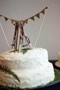 Tiny wooden skis to top a winter wedding cake