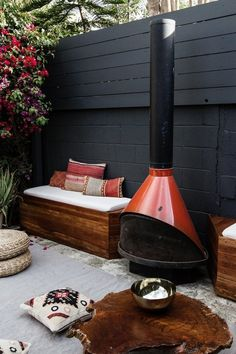 There something about Smitten Studio's tall dark walls that make her backyard feel cozier and more private. It's counter-intuitive for an outdoor space but it works.
