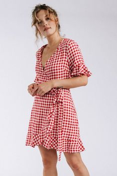 Details: Red checkered wrap dress 100% Rayon Measurements: Measurements are approximate and taken while laying flat across the front. Not doubled. S: Bust = 40.00cm; Length = 62.00cm M: Bust = 42.00cm; Length = 63.00cm L: Bust = 46.00cm; Length = 64.00cm