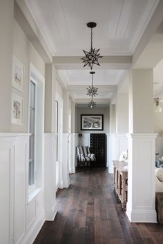 Neutral hallway with black and white accents