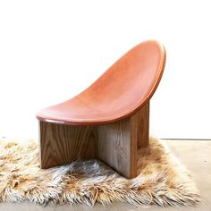 Sculptural leather and wood scoop-backed lounge chair. Modern Furniture, Furniture Design, Conceptual Design, White Oak, Restaurant Bar, Chair Design, Heeled Mules, Sculpture, Leather
