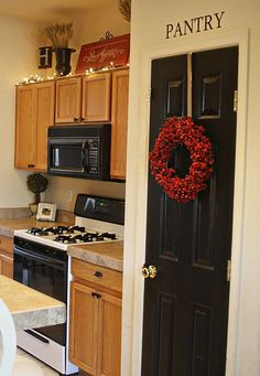 black doors plus wreath and pantry sign. Love it all