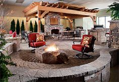 Beautiful patio layout with custom stone work and one-of-a-kind rock fire pit.