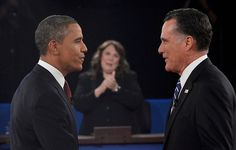 138 10/16/12 - Republican presidential nominee Mitt Romney, right, greets President Barack Obama, left, at the start of their second presidential debate in Hempstead, N.Y., on Oct. 16, 2012. Moderator Candy Crowley applauds at center. (REUTERS/Michael Reynolds, Pool