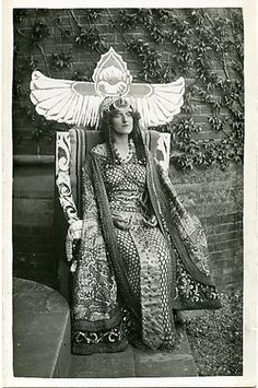 Dorothy Green is posed on her throne in front of the familiar ivy-covered wall of the Theatre in Stratford. Green played Cleopatra at the Shakespeare Memorial Theatre four times, in 1912 (with Sir Frank Benson as Antony), 1921, 1924, and 1927.  The photographer is not cited and no publisher is credited, although it is probably Spencer, Photographic Chemist, of Stratford. The same company published most of the other cards for the actors in Benson's company.