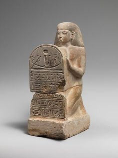 Stelophorous Statue of Bay, a scribe in the reign of Seti I  1294-1250 b.c.
