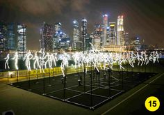 A light installation created by the French design/artist studio Groupe LAPS consists static stick figures made out of LED light tubes, It Works with music to create a choreographed display of movement, displayed for iLight at Marina Bay Singapore