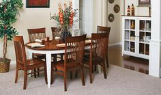I kinda like the white and wood colors of this oval table. It's from the website of the store where I bought my sofa.