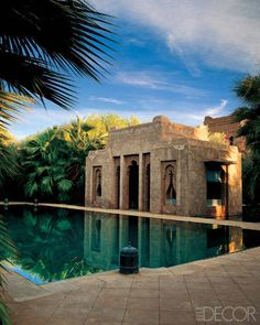 Trimmed with handmade Moroccan bricks outlining the shape of Arabic scent bottles, an open-air pavilion makes an opulent addition to a spring-fed pool at hotel impresario Jaouad Kadiri's Marrakech country house, designed by architect Stuart Church; the area is shaded by Washingtonia palms. - ELLEDecor.com