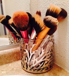 DIY makeup brush holder! I made this from a bath & body works candle