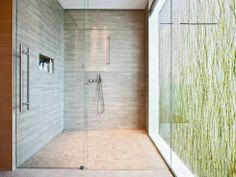 If my shower were the size of my whole bathroom, I'd do this!  EcoResin panel in window.
