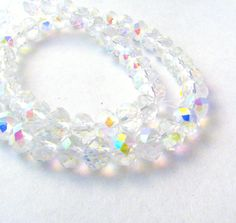 20 Clear Aurora Borealis Rainbow Faceted Crystal Rondelle Beads with AB Finish - Sizes Small, Medium, & Large - 4mm - 8mm by MesmericMatter on Etsy https://www.etsy.com/listing/186623242/20-clear-aurora-borealis-rainbow-faceted