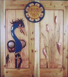 Closet Doors. Coast Salish. Heron and Bullrushes designed and carved by Herb Rice.  Nice copper inlays.