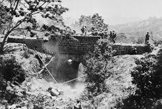 The Battle of Imphal-Kohima March - July 1944: Men of the West Yorkshire Regiment clear a roadblock on the Imphal-Kohima Road.