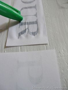 you print out words on basic white paper, but in mirror image form lay them on the wood with a damp paint brush wet the paper on top of the words use the cap of a sharpie to rub on top of the letters to help them transfer  then remove the paper and stand in shock and awe!