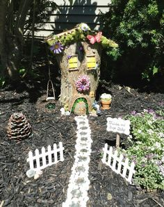 Fairy house & garden from old tree stump and a bunch of leftover craft supplies