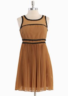 """Humboldt Pleated Dress 69.99 at shopruche.com. Make an elegant statement in this impeccably crafted chiffon dress in camel with golden undertones and black appliques. Polished with soft pleats for movement and sheer upper panels. Back button and hidden zipper closures. Fully lined.  Self: 100% Polyester, Trim: 100% Polyester, Lining: 95% Polyester, 5% Spandex, Imported, 34"""" length from top of shoulder"""