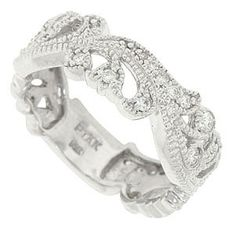 Delicate swags of diamond encrusted blossoms and curling leaves dance across the face of this 14K white gold floral designed wedding band. The organic floral wedding ring is set with .34 carat total weight of round diamonds. The ring measures 6.90 mm in width. Size 6 1/2. We can re-size or reorder in any size. Available in 18K, yellow gold and platinum.