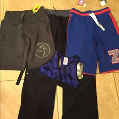 Zumba NWT bundle if 4 size S/M. #412 NWT bundle includes a pair of cargo pants size M a pair of blue terry shorts size S a pair of blue terry shirts size S a blue sports bra size M tags attached no flaws Zumba Other