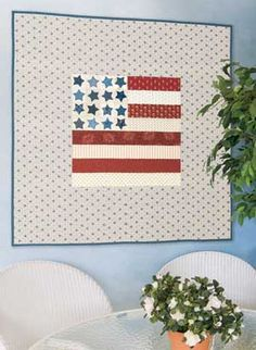"$9.00.  Frame an easy pieced and fusible-appliqued flag with a wide border for this 40"" x 40"" quilt.   Pattern includes Teri Christopherson's directions."
