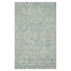 Define an area in your living room or master suite with this hand-tufted wool rug, showcasing a tonal ogee motif.    Product: Rug
