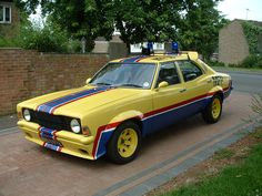 Mk3 ford cortina modified for a Mad Max chase car look. ( wide arch, racing stripes )