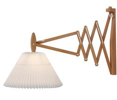 The Sax Wall Lamp was designed by Erik Hansen in and will be prefect in any room of your home. Available with a Light Oak, Beech or Walnut wood flexible arm. The classical Le KLINT lampshade magnificently complements nature's own materials. Plug In Wall Lamp, Compact Fluorescent Bulbs, Paper Lampshade, Light Oak, Downlights, Ceiling Lamp, Home Lighting, Wall Sconces, Mirrors