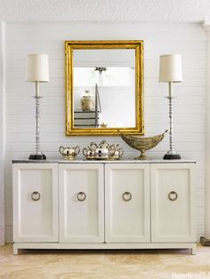 """If you can believe it, this vintage dining room sideboard was a DIY project. The owner painted it white and silver-leafed the top. """"Silver leaf is simple,"""" she says, """"It comes in little sheets that you apply to a glued surface. There's not a whole lot more to it than that."""" Pin it »"""