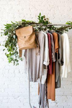 studio boutique photo shoot rolling rack clothes inspo