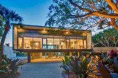 This modern home's elevated rectangular structure captures water views of both the Gulf of Mexico and Little Sarasota Bay.