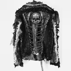 Custom jackets by Chad Cherry. Distressed, studded, laced up, heavy metal, punk rock, rocker jacket from Chad Cherry Clothing.